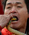 A performer prepares to insert the head of a live snake into his mouth during a performance at the Ditan Temple Fair celebrating the Chinese Lunar New Year in Beijing February 11, 2013. REUTERS/Jason Lee