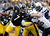 Ben Roethlisberger #7 of the Pittsburgh Steelers avoids a sacks by Jarret Johnson #96 of the San Diego Chargers on December 9, 2012 at Heinz Field in Pittsburgh, Pennsylvania.  (Photo by Joe Sargent/Getty Images)