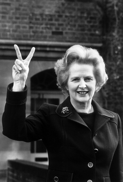 Description of . November 1976:  Conservative party leader Margaret Thatcher makes a 'victory' sign outside her home in Chelsea, London.  (Photo by John Minihan/Evening Standard/Getty Images)