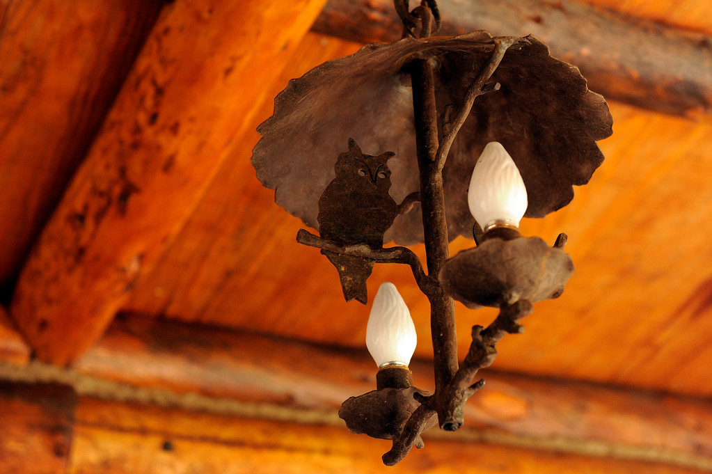 Description of . PINE, CO - APRIL 18: Original ironwork featured on a lamp at Baehrden Lodge on April 18, 2014, in Pine, Colorado. (Photo by Anya Semenoff/The Denver Post)