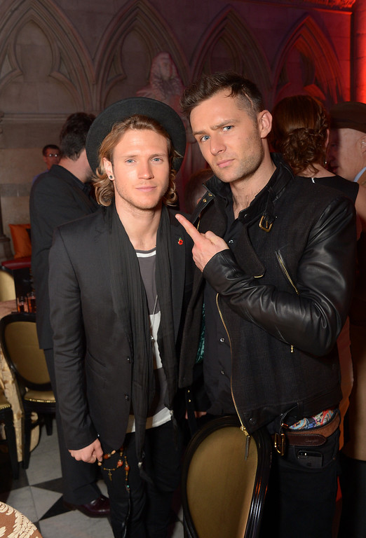 Description of . Dougie Poynter and Harry Judd from McFly attend the 'The Hunger Games: Catching Fire' Premiere After-Party, on Monday Nov. 11, 2013 in the Royal Court of Justice, London. 'Catching Fire' is the second instalment in 'The Hunger Games' trilogy. (Photo by Jon Furniss/Invision/AP)