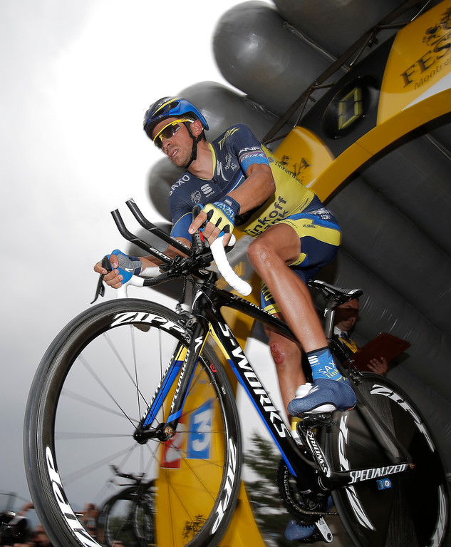 Description of . Spain's Alberto Contador takes the start of the seventeenth stage of the Tour de France cycling race an individual time trial over 32 kilometers (20 miles) with start in Embrun and finish in Chorges, France, Wednesday July 17, 2013. (AP Photo/Christophe Ena)