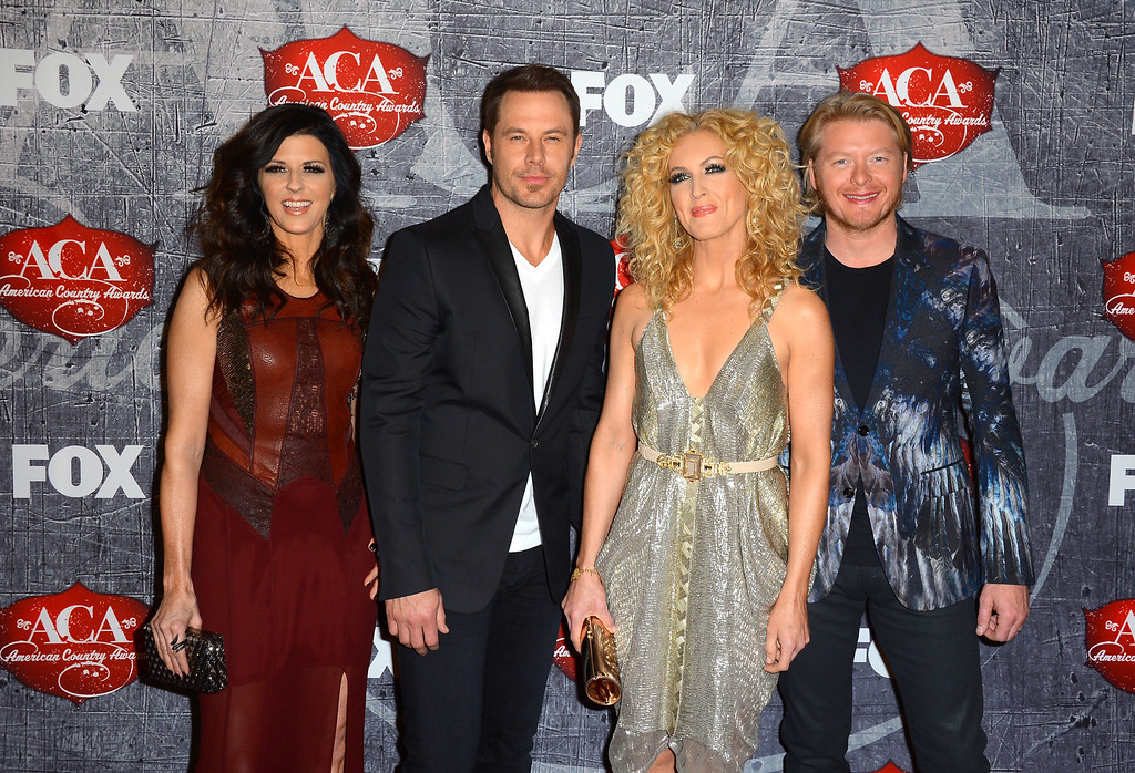 Description of . LAS VEGAS, NV - DECEMBER 10:  (L-R) Karen Fairchild, Jimi Westbrook, Kimberly Roads Schlapman and Phillip Sweet of Little Big Town arrive at the 2012 American Country Awards at the Mandalay Bay Events Center on December 10, 2012 in Las Vegas, Nevada.  (Photo by Frazer Harrison/Getty Images)