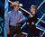 LAS VEGAS, NV - DECEMBER 10:  (L-R) Presenters Dustin Lynch and Carmen Electra speak onstage during the 2012 American Country Awards at the Mandalay Bay Events Center on December 10, 2012 in Las Vegas, Nevada.  (Photo by Mark Davis/Getty Images)