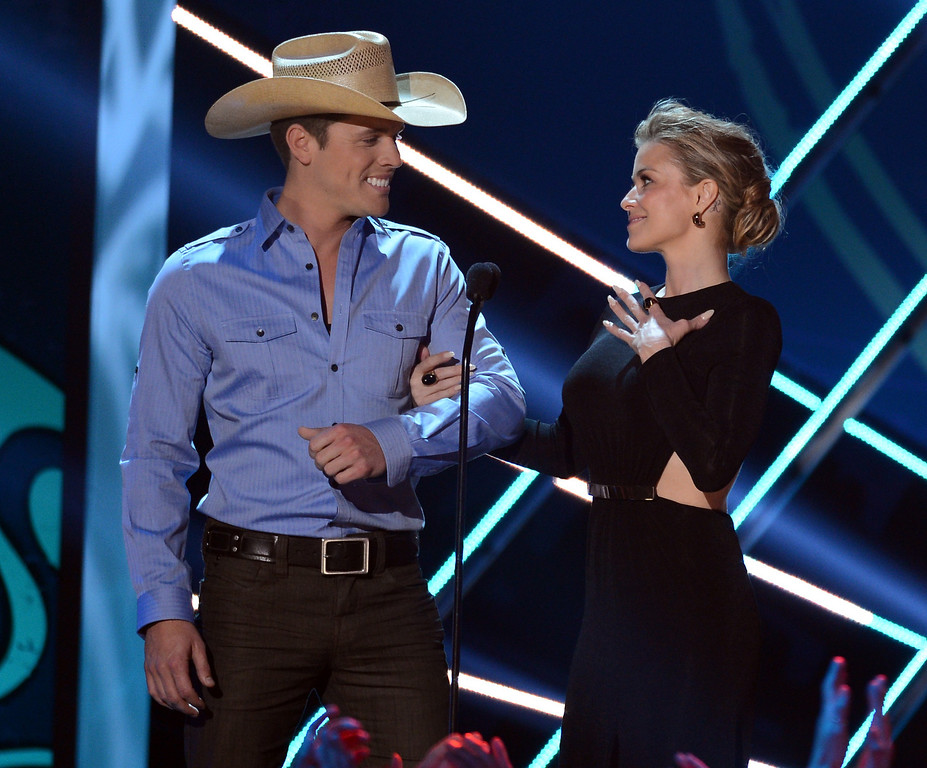 Description of . LAS VEGAS, NV - DECEMBER 10:  (L-R) Presenters Dustin Lynch and Carmen Electra speak onstage during the 2012 American Country Awards at the Mandalay Bay Events Center on December 10, 2012 in Las Vegas, Nevada.  (Photo by Mark Davis/Getty Images)