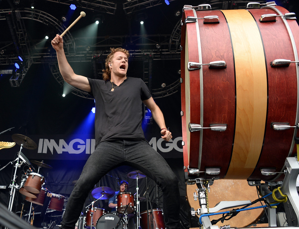 Description of . CHICAGO, IL - AUGUST 02:  Dan Reynolds of Imagine Dragons performs during Lollapalooza 2013 at Grant Park on August 2, 2013 in Chicago, Illinois.  (Photo by Theo Wargo/Getty Images)
