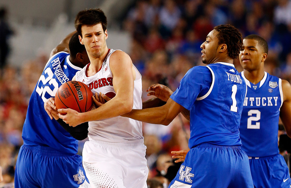 Description of . ARLINGTON, TX - APRIL 05: Duje Dukan #13 of the Wisconsin Badgers battles with James Young #1 of the Kentucky Wildcats during the NCAA Men's Final Four Semifinal at AT&T Stadium on April 5, 2014 in Arlington, Texas.  (Photo by Tom Pennington/Getty Images)