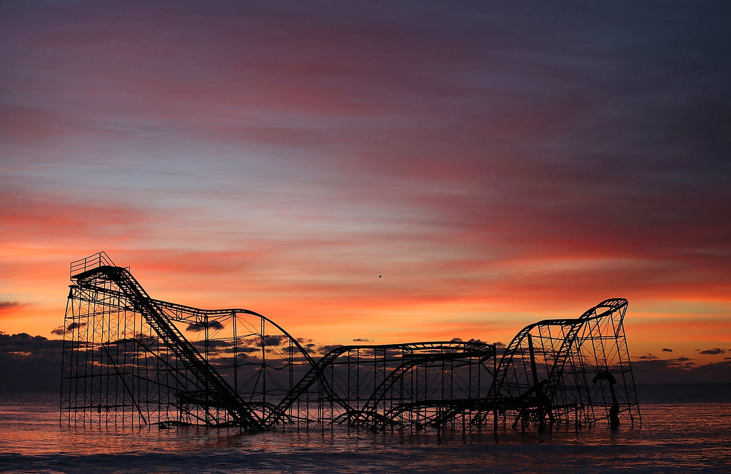 . A roller coaster sits in the ocean after the Casino Pier collapsed when Superstorm Sandy hit, on November 25, 2012 in Seaside Heights, New Jersey. Mayor Bill Akers has asked the Coast Guard to find out whether the coaster is structurally stable, adding that it would make a great tourist attraction. (Photo by Mark Wilson/Getty Images)