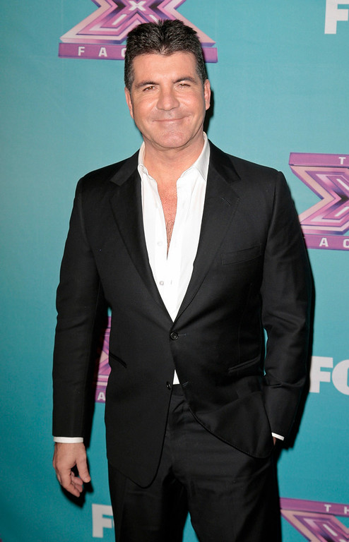". Producer Simon Cowell poses following Fox\'s ""The X Factor\"" Season Finale - Night 2 at CBS Television City in Los Angeles, California December 20, 2012. REUTERS/Jason Redmond"