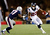 Arian Foster #23 of the Houston Texans runs with the ball against Alfonzo Dennard #37 of the New England Patriots during the 2013 AFC Divisional Playoffs game at Gillette Stadium on January 13, 2013 in Foxboro, Massachusetts.  (Photo by Jim Rogash/Getty Images)