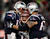 New England Patriots quarterback Tom Brady (L) celebrates his first half touchdown pass against the Baltimore Ravens with center Ryan Wendell (62) during the NFL AFC Championship football game in Foxborough, Massachusetts, January 20, 2013. REUTERS/Adam Hunger