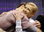 Tatiana Volosozhar and Maxim Trankov, of Russia, react as they watch their scores during the pairs free skate program at the World Figure Skating Championships Friday, March 15, 2013, in London, Ontario. (AP Photo/Darron Cummings)