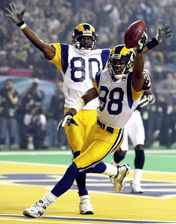 . St. Louis Rams wide receiver Torry Holt (R) and wide receiver Isaac Bruce (L) celebrate Holt\'s touchdown catch during second half action in Super Bowl XXXIV at the Georgia Dome in Atlanta, GA 30 January, 2000. ROBERTO SCHMIDT/AFP/Getty Images
