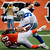 Dallas Cowboys quarterback Tony Romo (9) is sacked by Cincinnati Bengals defensive end Michael Johnson (93) in the first half of an NFL football game, Sunday, Dec. 9, 2012, in Cincinnati. (AP Photo/Michael Keating)