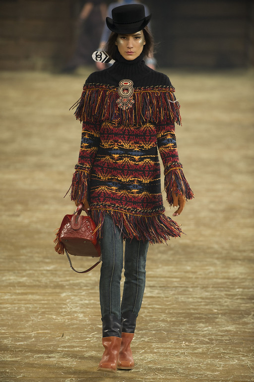 Description of . A model walks the runway during the Chanel