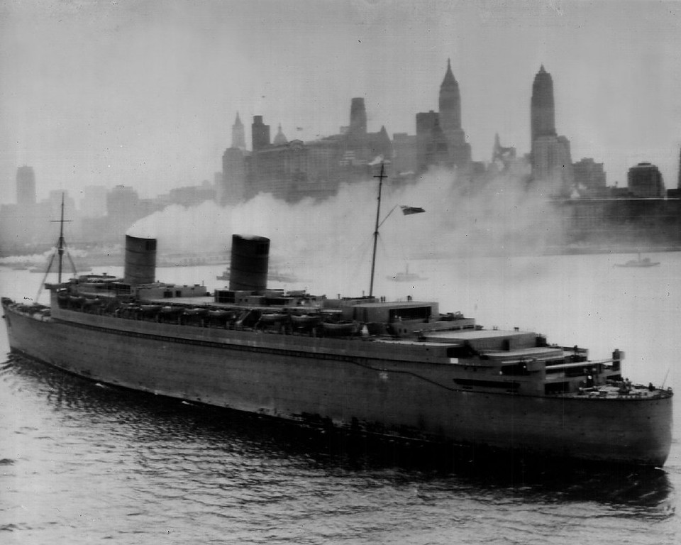 . With Manhattan\'s skyline in the background, the huge British liner Queen Elizabeth, safe after a spectacular dash across the Atlantic, moves up the harbor today toward a Berth in the North River. 1940