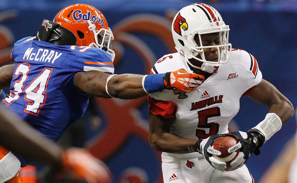 Description of . Louisville quarterback Teddy Bridgewater (5) is sacked by Florida linebacker Lerentee McCray (34) in the first half of the Sugar Bowl NCAA college football game Wednesday, Jan. 2, 2013, in New Orleans. (AP Photo/Butch Dill)