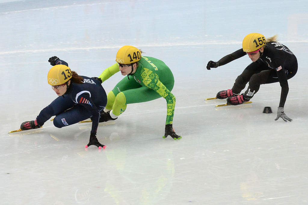 . (L-R) South Korea\'s Park Seunghi, Lithuania\'s Agne Sereikaite and US Emily Scott compete in the Women\'s Short Track 500 m Heats at the Iceberg Skating Palace during the Sochi Winter Olympics on February 10, 2014.   DAMIEN MEYER/AFP/Getty Images