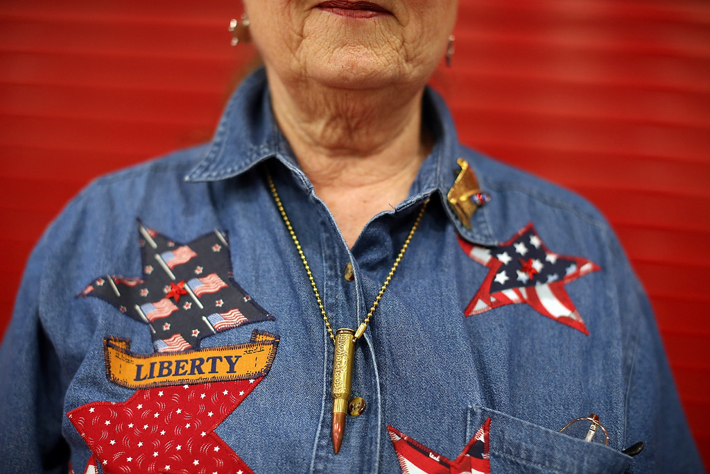 Description of . HOUSTON, TX - MAY 04:  Ann Peay wears a bullet necklace during the 2013 NRA Annual Meeting and Exhibits at the George R. Brown Convention Center on May 4, 2013 in Houston, Texas.  More than 70,000 peope are expected to attend the NRA's 3-day annual meeting that features nearly 550 exhibitors, gun trade show and a political rally. The Show runs from May 3-5.  (Photo by Justin Sullivan/Getty Images)