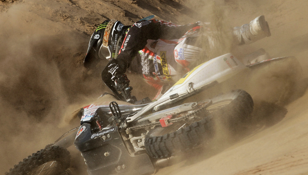 Description of . Husqvarna rider Alessandro Botturi of Italy, falls from his motorcycle during the 3nd stage of the 2013 Dakar Rally from Pisco to Nazca, Peru, Monday, Jan. 7, 2013. The race finishes in Santiago, Chile, on Jan. 20. (AP Photo/Victor R. Caivano)