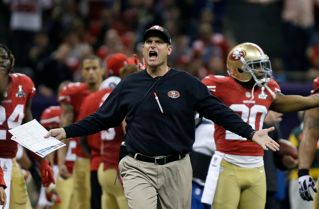 Description of . San Francisco 49ers head coach Jim Harbaugh reacts during the first half of the NFL Super Bowl XLVII football game against the Baltimore Ravens, Sunday, Feb. 3, 2013, in New Orleans. (AP Photo/Matt Slocum)