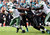 New York Jets quarterback Mark Sanchez (L) is tackled by Jacksonville Jaguars defensive lineman Jeremy Mincey (C) during the second half of their NFL football game in Jacksonville, Florida December 9, 2012. REUTERS/Daron Dean