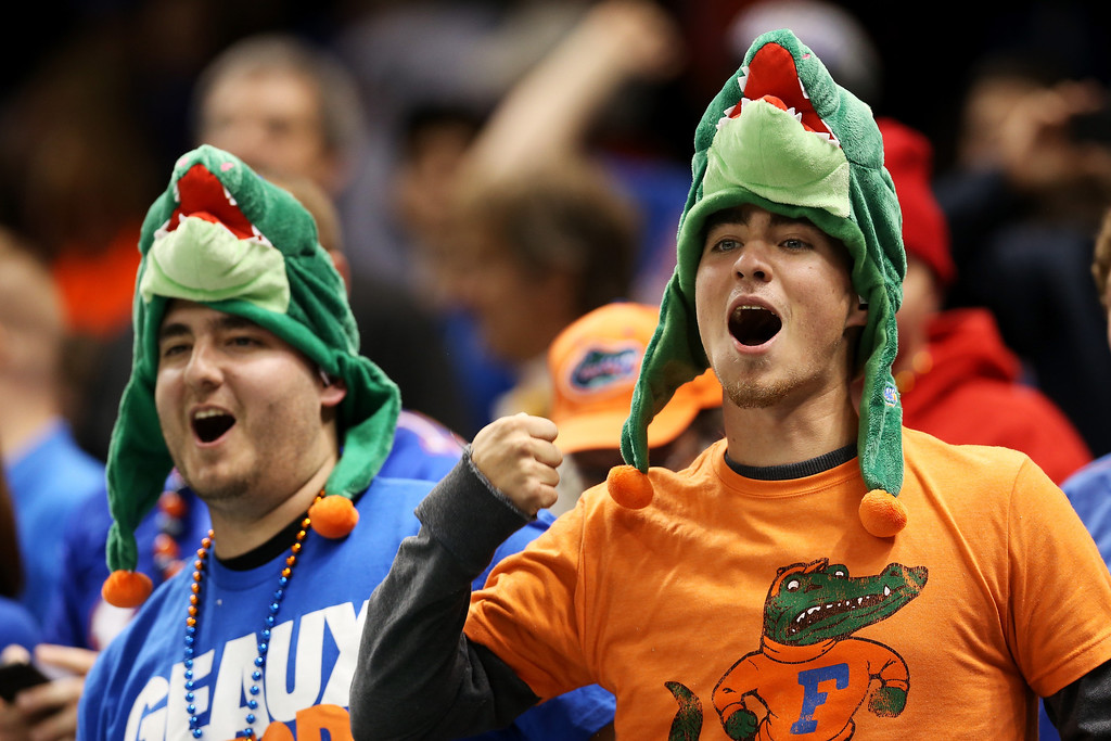 Description of . Florida Gators fans watch the Allstate Sugar Bowl against the Louisville Cardinals at Mercedes-Benz Superdome on January 2, 2013 in New Orleans, Louisiana.  (Photo by Matthew Stockman/Getty Images)