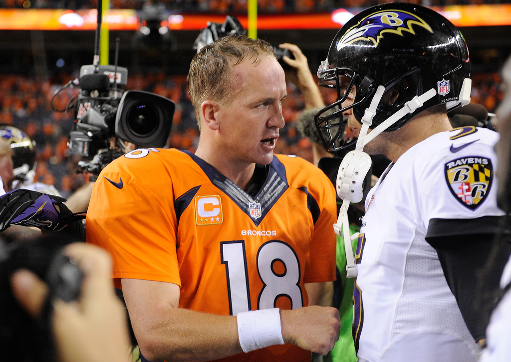 Description of . Denver Broncos quarterback Peyton Manning (18) talks with Baltimore Ravens quarterback Joe Flacco (5) after the game. The Denver Broncos took on the Baltimore Ravens in the first game of the 2013 season at Sports Authority Field at Mile High in Denver on September 5, 2013. (Photo by AAron Ontiveroz/The Denver Post)