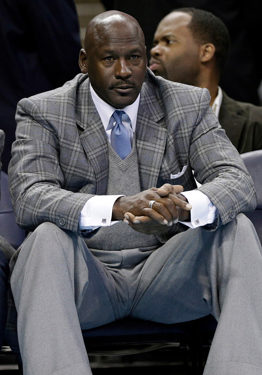Description of . Charlotte Bobcats owner Michael Jordan watches during the second half of an NBA basketball game between the Charlotte Bobcats and the Atlanta Hawks in Charlotte, N.C., Wednesday, Jan. 23, 2013. Atlanta won 104-92. (AP Photo/Chuck Burton)