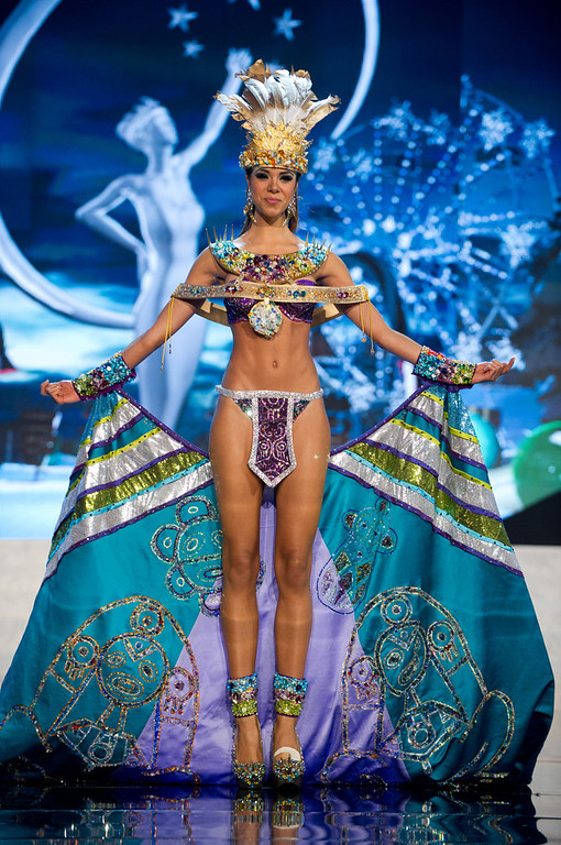 Description of . Miss Puerto Rico 2012, Bodine Koehler, performs onstage at the 2012 Miss Universe National Costume Show on Friday, Dec. 14, 2012 at PH Live in Las Vegas, Nevada. The 89 Miss Universe Contestants will compete for the Diamond Nexus Crown on Dec. 19, 2012. (AP Photo/Miss Universe Organization L.P., LLLP)