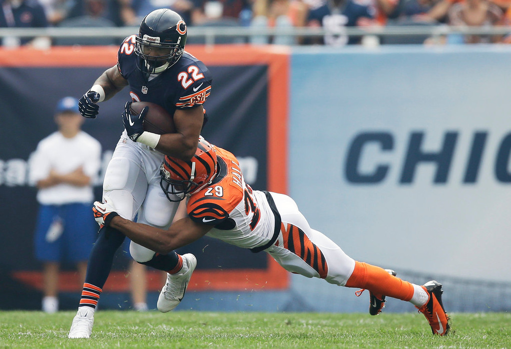 Description of . Cincinnati Bengals cornerback Leon Hall (29) tackles Chicago Bears running back Matt Forte (22) during the first half of an NFL football game, Sunday, Sept. 8, 2013, in Chicago. (AP Photo/Nam Y. Huh)