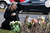 Andrea Jaeger places flowers and a candle at a makeshift memorial outside a firehouse which was used as a staging area for families following the mass shooting at Sandy Hook Elementary School on December 15, 2012 in Newtown, Connecticut.   Twenty six people were shot dead, including twenty children, after a gunman identified as Adam Lanza in news reports opened fire in the school. Lanza also reportedly had committed suicide at the scene.  (Photo by Mario Tama/Getty Images)