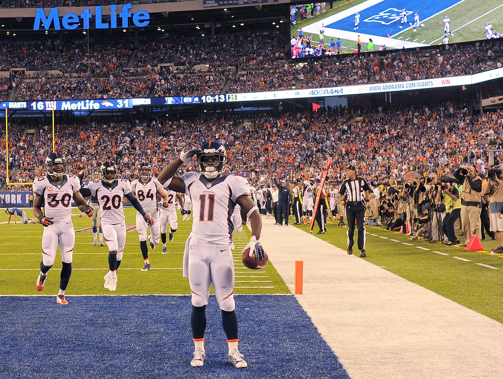 Description of . Denver Broncos wide receiver Trindon Holliday (11) salutes the crowd after returning a punt 81 yards for a touchdown during the fourth quarter September 15, 2013 MetLife Stadium. (Photo by John Leyba/The Denver Post)