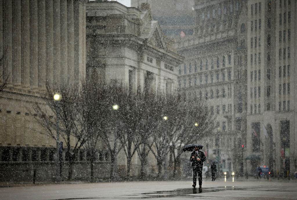 Description of . A pedestrian walks down Pennsylvania Ave near the White House in Washington, Wednesday, March 6, 2013. Schools, businesses and the federal government closed in anticipation of a snow storm that could blanket the region. (AP Photo/Pablo Martinez Monsivais)