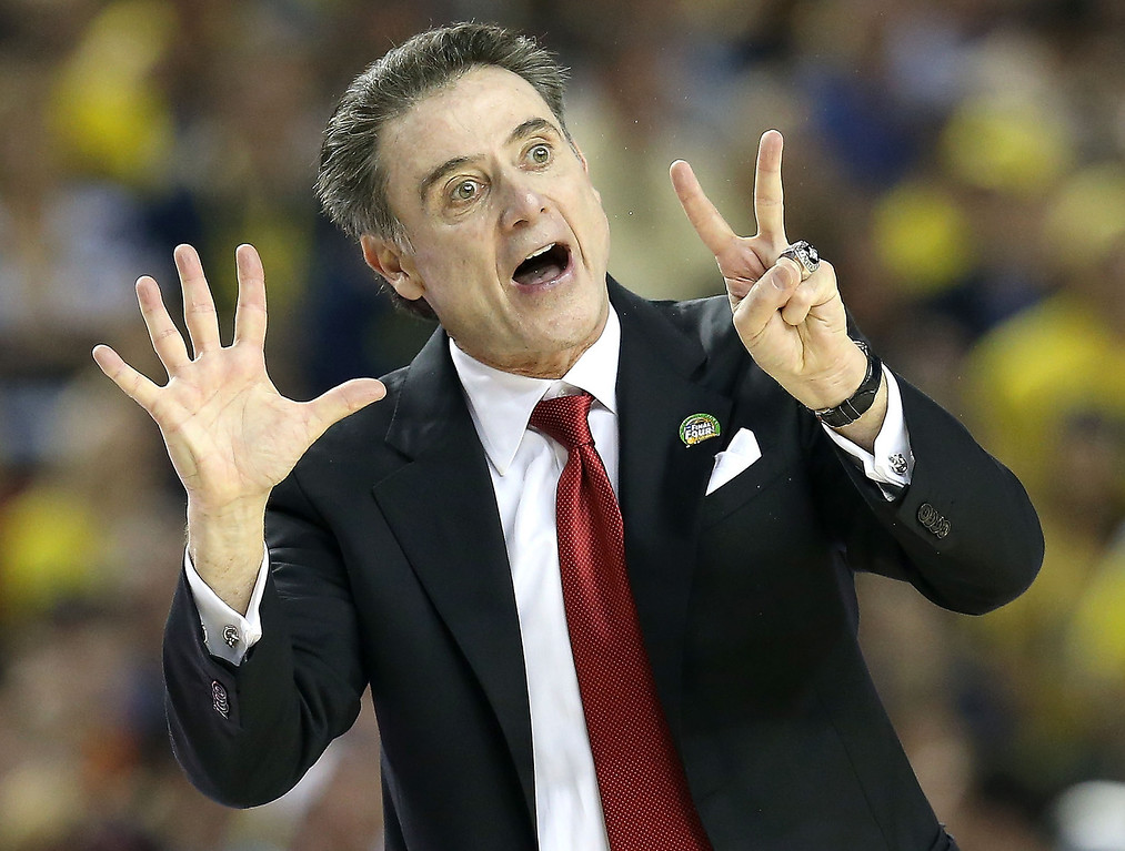 Description of . Head coach Rick Pitino of the Louisville Cardinals reacts in the first half against the Michigan Wolverines during the 2013 NCAA Men's Final Four Championship at the Georgia Dome on April 8, 2013 in Atlanta, Georgia.  (Photo by Streeter Lecka/Getty Images)