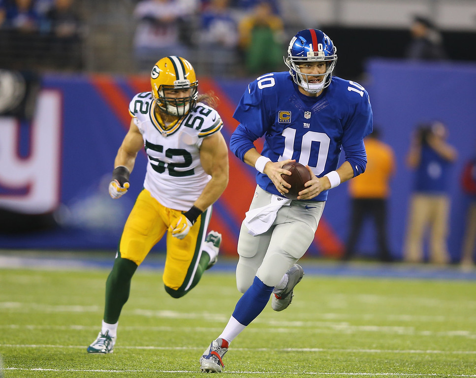 Description of . Eli Manning #10 of the New York Giants scrambles against the Green Bay Packers during their game at MetLife Stadium on November 17, 2013 in East Rutherford, New Jersey.  (Photo by Al Bello/Getty Images)