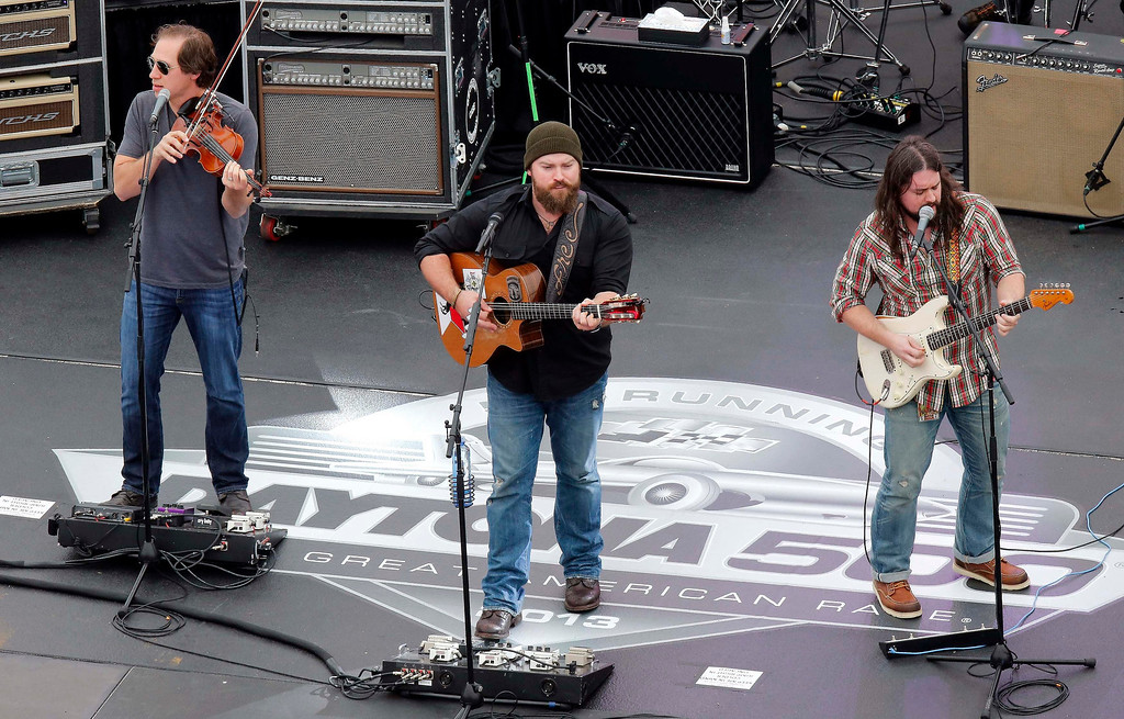 . Members of the Zac Brown Band perform before the start of the NASCAR Sprint Cup Series Daytona 500 race at the Daytona International Speedway in Daytona Beach, Florida February 24, 2013. REUTERS/Pierre Ducharme (UNITED STATES - Tags: SPORT MOTORSPORT ENTERTAINMENT)