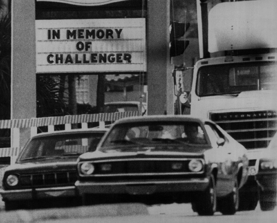 Description of . Motorists en route to work Wednesday morning passed this sign in memory of the Space Shuttle Challenger which exploded shortly after liftoff Tuesday killing the crew of seven. Denver Post Library Archive