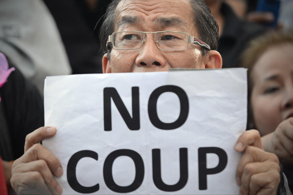 Description of . A protester holds a sign during a city centre anti-coup rally on May 23, 2014 in Bangkok, Thailand. Anti-coup protesters rallied in Bangkok\'s shopping district, a day after the military seized control in a bloodless coup. (Photo by Rufus Cox/Getty Images)