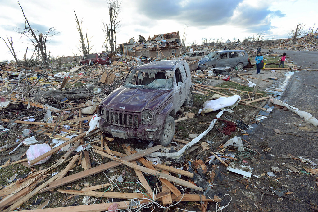 Description of . Demolished homes and vehicles in the Devonshire Subdivision in Washington, Ill., Sunday, Nov. 17, 2013. Intense thunderstorms and tornadoes swept across the Midwest, causing extensive damage in several central Illinois communities while sending people to their basements for shelter. (AP Photo/The Pantagraph, Steve Smedley)