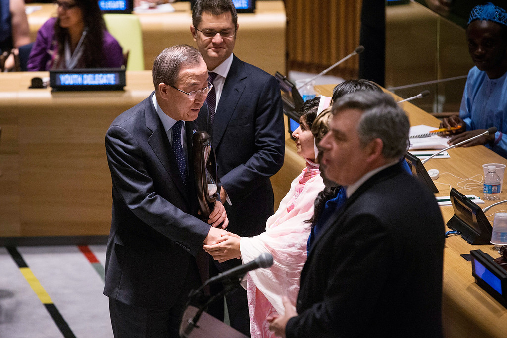 "Description of . NEW YORK, NY - JULY 12:  United Nations Secretary General Ban-ki Moon (L) shakes hands with Malala Yousafzai, the 16-year-old Pakistani advocate for girls education who was shot in the head by the Taliban, at the United Nations (UN) Youth Assembly on July 12, 2013 in New York City. The United Nations declared July 12, ""Malala Day.\"" Yousafzai also celebrates her birthday today.  (Photo by Andrew Burton/Getty Images)"