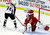 Detroit Red Wings goalie Jimmy Howard (35) deflects a shot by Colorado Avalanche right wing P.A. Parenteau (15) during the third period of an NHL hockey game in Detroit, Tuesday, March 5, 2013. Detroit won 2-1. (AP Photo/Carlos Osorio)