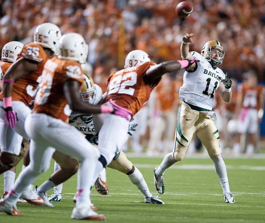 Description of . Nick Florence #11 of the Baylor University Bears throws a pass during the Big 12 Conference game against the Texas Longhorns on October 20, 2012 at Darrell K Royal-Texas Memorial Stadium in Austin, Texas.  (Photo by Cooper Neill/Getty Images)