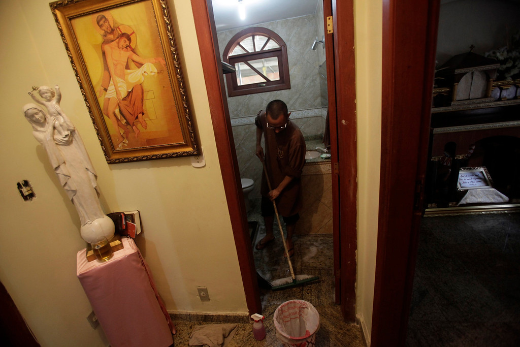 Description of . Brother Marcos Martins, member of Franciscan fraternity, O Caminho, cleans a bathroom at the fraternity's house in the Campo Grande neighborhood of Rio de Janeiro April 2, 2013. O Caminho (The Way) are a group of Franciscan monks and nuns who help the homeless on the streets of Rio de Janeiro. They consider the election of Pope Francis, the first pontiff to take the name of St Francis of Assisi, to be a confirmation of their beliefs in poverty and simplicity. In July, Pope Francis will visit Rio de Janeiro in his first international trip since assuming the papacy. Picture taken April 2, 2013. REUTERS/Ricardo Moraes