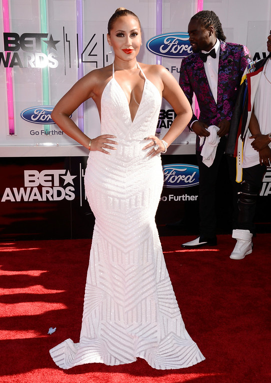 Description of . Adrienne Bailon arrives at the BET Awards at the Nokia Theatre on Sunday, June 29, 2014, in Los Angeles. (Photo by Dan Steinberg/Invision/AP)