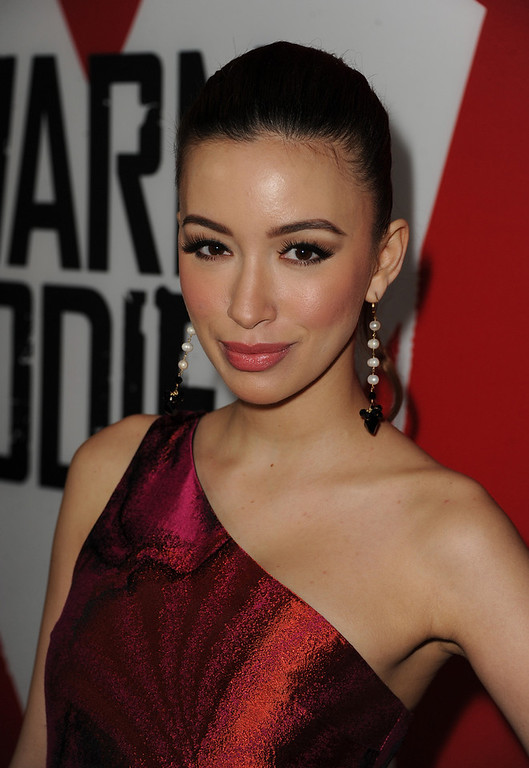 "Description of . Actress Christian Serratos arrives for the Los Angeles premiere of Summit Entertainment\'s ""Warm Bodies\"" at ArcLight Cinemas Cinerama Dome on January 29, 2013 in Hollywood, California.  (Photo by Kevin Winter/Getty Images)"