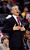 Charlotte Bobcats coach Mike Dunlap reacts to a call that went the Denver Nuggets' way during the second half of an NBA basketball game in Charlotte, N.C., Saturday, Feb. 23, 2013. The Nuggets won 113-99. (AP Photo/Bob Leverone)