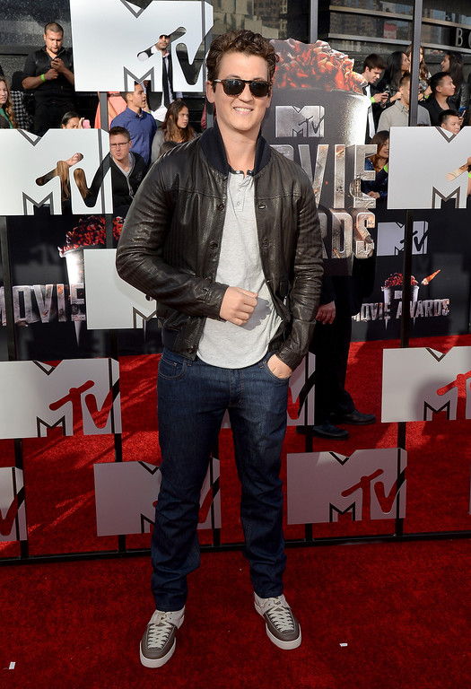 Description of . Actor Miles Teller attends the 2014 MTV Movie Awards at Nokia Theatre L.A. Live on April 13, 2014 in Los Angeles, California.  (Photo by Michael Buckner/Getty Images)