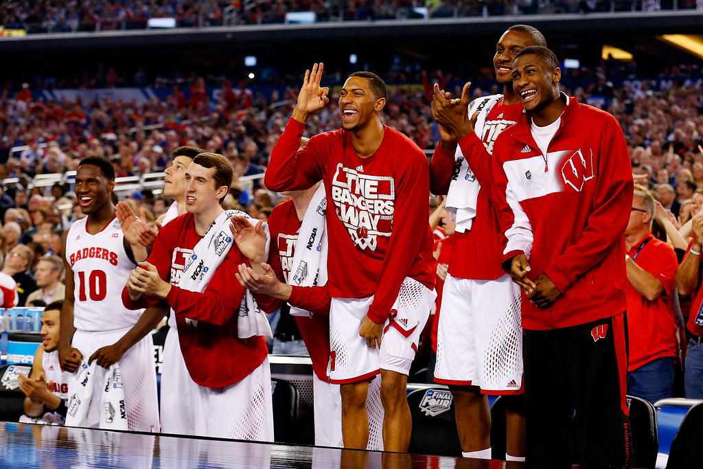 Description of . ARLINGTON, TX - APRIL 05: The Wisconsin Badgers bench reacts during the NCAA Men's Final Four Semifinal against the Kentucky Wildcats at AT&T Stadium on April 5, 2014 in Arlington, Texas.  (Photo by Tom Pennington/Getty Images)