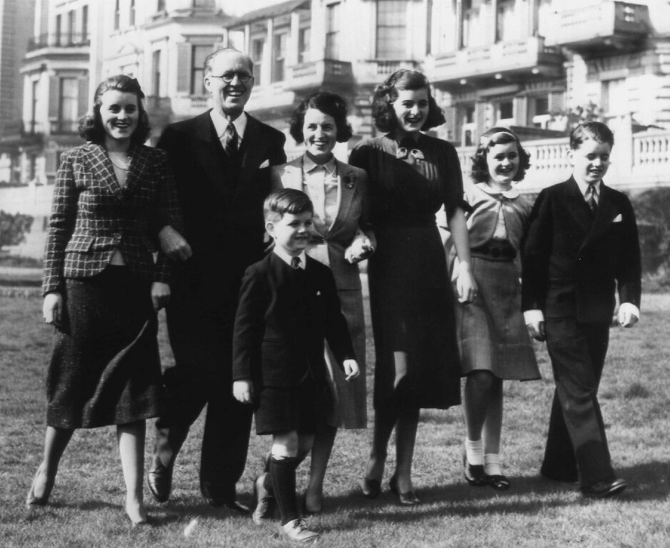 Description of . Joseph Kennedy, the new U.S. ambassador to the Court of St. James, jestingly said he didn't want to add to Britain's housing problem by bringing over his family: Mrs. Kennedy and nine children all at once. So they arrived in small groups. Teddy leads the way as, from left, Kathleen, Mrs. Kennedy, Patricia, Jean and Bobby walk along. Denver Post file
